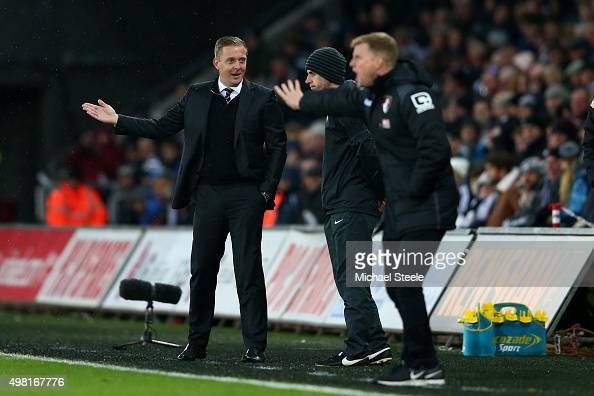 Garry Monk Manager of Swansea City talks to the fourth official during the Barclays Premier League match between Swansea City and AFC Bournemouth at...