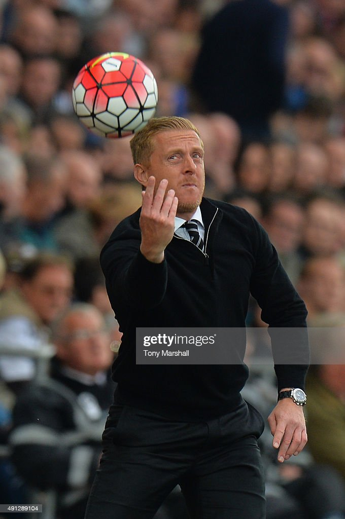Garry Monk manager of Swansea City tosses the ball during the Barclays Premier League match between Swansea City and Tottenham Hotspur at Liberty Stadium on October 4, 2015 in Swansea, Wales.