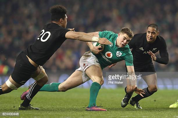 Garry Ringrose of Ireland is tackled by Ardie Savea of New Zealand during the international rugby match between Ireland and the New Zealand All...