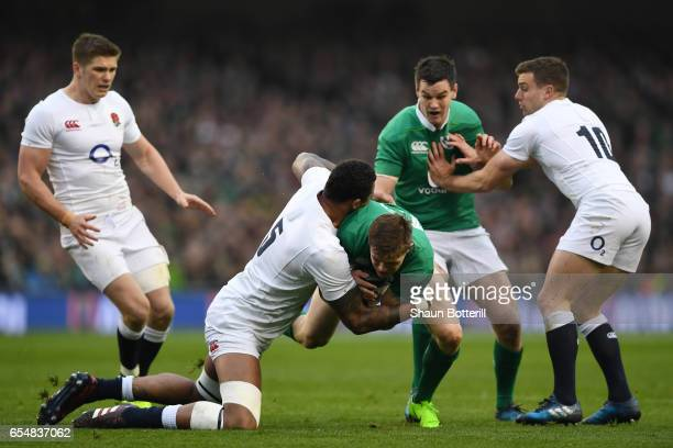 Garry Ringrose of Ireland is tackled by Courtney Lawes of England during the RBS Six Nations match between Ireland and England at the Aviva Stadium...