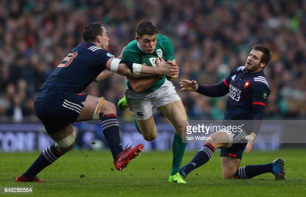 Garry Ringrose of Ireland is tackled by Louis Picamoles of France during the RBS Six Nations match between Ireland and France at the Aviva Stadium on...