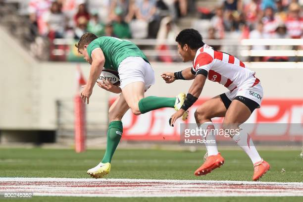 Garry Ringrose of Ireland makes a break to score try during the international rugby friendly match between Japan and Ireland at Ajinomoto Stadium on...