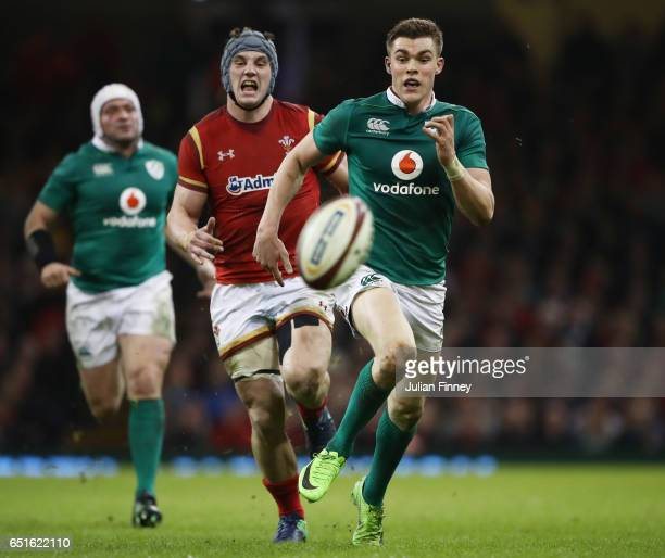 Garry Ringrose of Ireland runs for a loose ball with Jonathan Davies of Wales during the Six Nations match between Wales and Ireland at the...