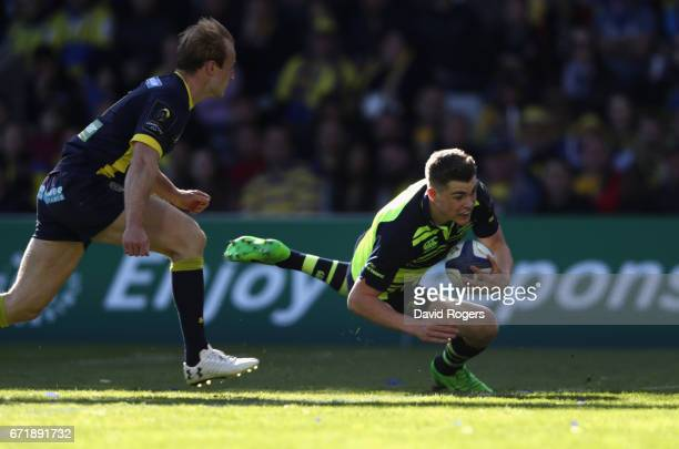 Garry Ringrose of Leinster breaks clear of Nick Abendanon to score a try during the European Rugby Champions Cup semi final match between ASM...