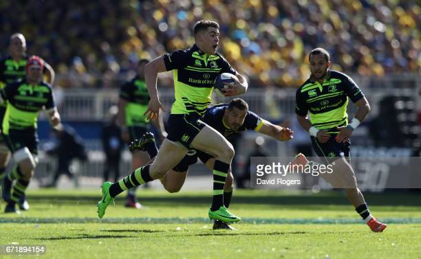 Garry Ringrose of Leinster breaks clear to score a try during the European Rugby Champions Cup semi final match between ASM Clermont Auvergne and...