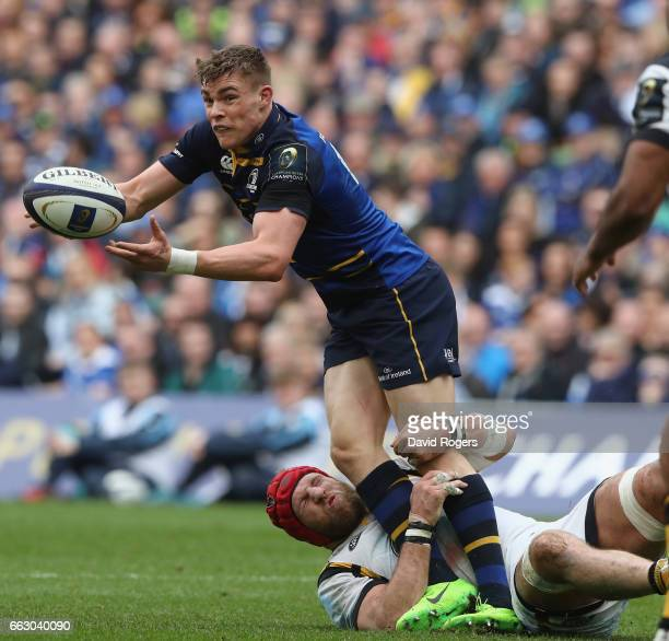 Garry Ringrose of Leinster off loads the ball as James Haskell tackles during the European Rugby Champions Cup match between Leinster and Wasps at...