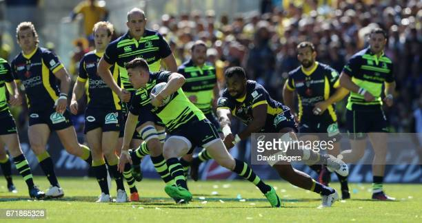 Garry Ringrose of Leinster runs with the ball during the European Rugby Champions Cup semi final match between ASM Clermont Auvergne and Leinster at...
