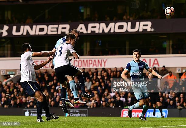 Garry Thompson of Wycombe Wanderers heads to score his side's third goal during the Emirates FA Cup Fourth Round match between Tottenham Hotspur and...