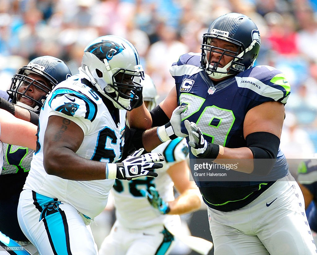 Garry Williams #65 of the Carolina Panthers blocks Red Bryant #79 of the Seattle Seahawks during play at Bank of America Stadium on September 8, 2013 in Charlotte, North Carolina. Seattle won 12-7.