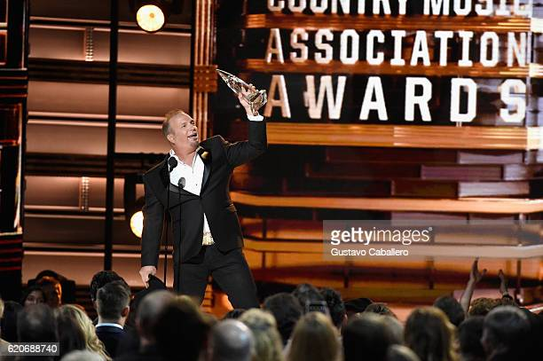 Garth Brooks accepts the Entertainer of the Year award onstage at the 50th annual CMA Awards at the Bridgestone Arena on November 2 2016 in Nashville...