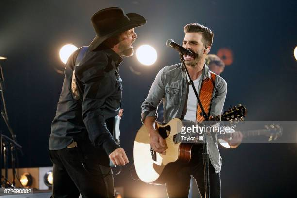 Garth Brooks and Mitch Rossell perform during the 51st annual CMA Awards at the Bridgestone Arena on November 8 2017 in Nashville Tennessee