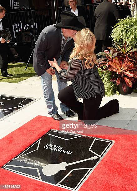 Garth Brooks and Trisha Yearwood are Inducted Into The Nashville Walk Of Fame Husband and Wife Honorees Garth Brooks joins Trisha Yearwood on her...