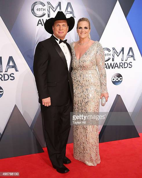 Garth Brooks and Trisha Yearwood attend the 49th annual CMA Awards at the Bridgestone Arena on November 4 2015 in Nashville Tennessee