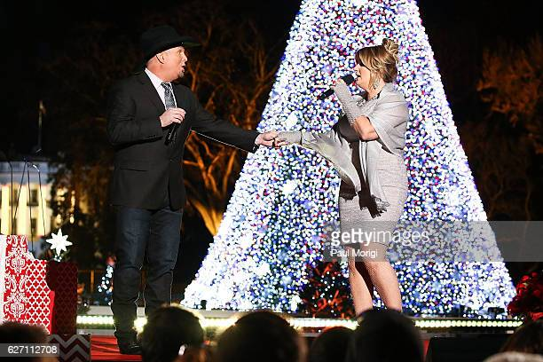 Garth Brooks and Trisha Yearwood perform during the 94th Annual National Christmas Tree Lighting Ceremony on the Ellipse in President's Park on...