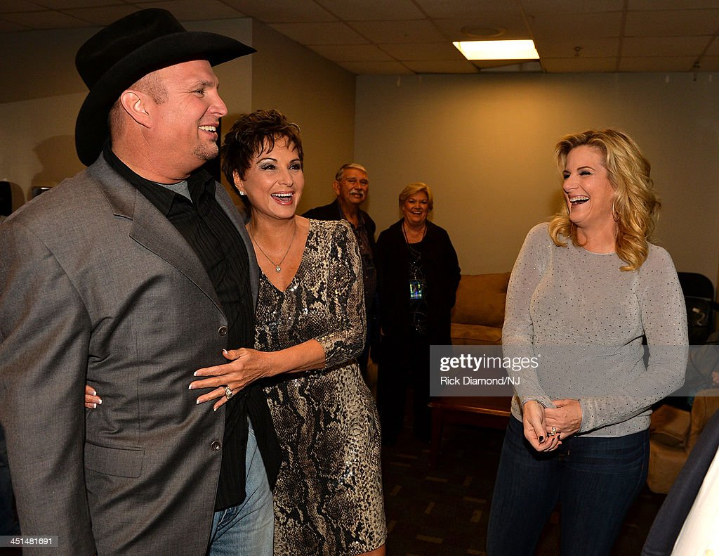 <a gi-track='captionPersonalityLinkClicked' href=/galleries/search?phrase=Garth+Brooks&family=editorial&specificpeople=206288 ng-click='$event.stopPropagation()'>Garth Brooks</a>, Nancy Jones and <a gi-track='captionPersonalityLinkClicked' href=/galleries/search?phrase=Trisha+Yearwood&family=editorial&specificpeople=216434 ng-click='$event.stopPropagation()'>Trisha Yearwood</a> laugh backstage during rehearsals for Playin' Possum! The Final No Show Tribute To George Jones at Bridgestone Arena on November 22, 2013 in Nashville, Tennessee.