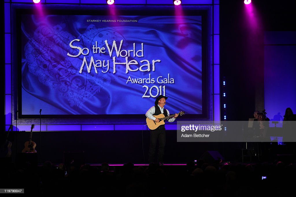 <a gi-track='captionPersonalityLinkClicked' href=/galleries/search?phrase=Garth+Brooks&family=editorial&specificpeople=206288 ng-click='$event.stopPropagation()'>Garth Brooks</a> performs at the Starkey Hearing Foundation's 'So The World May Hear Awards Gala' 2011 at River Centre on July 24, 2011 in St. Paul, Minnesota.