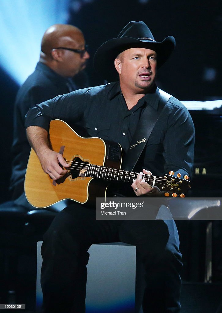 <a gi-track='captionPersonalityLinkClicked' href=/galleries/search?phrase=Garth+Brooks&family=editorial&specificpeople=206288 ng-click='$event.stopPropagation()'>Garth Brooks</a> performs onstage at the 'Teachers Rock' benefit event held at Nokia Theatre L.A. Live on August 14, 2012 in Los Angeles, California.