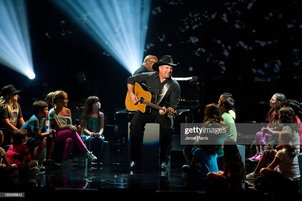 Garth Brooks performs onstage at the 'Teachers Rock' benefit event held at Nokia Theatre L.A. Live on August 14, 2012 in Los Angeles, California.