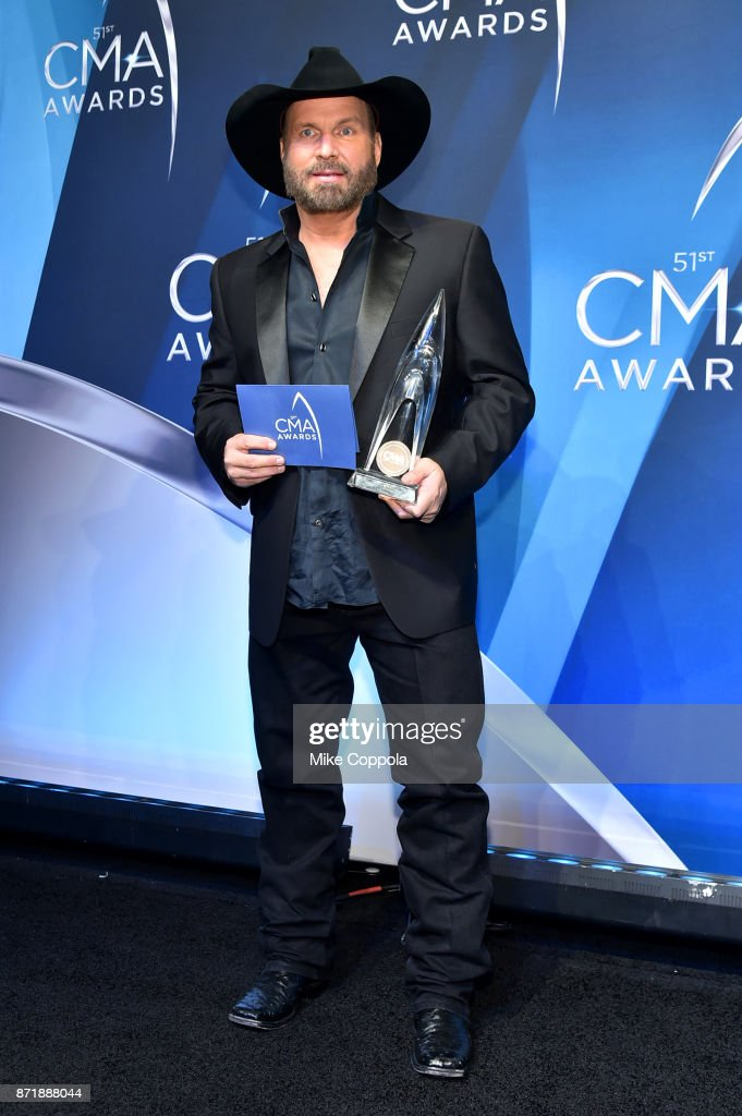 Garth Brooks poses with Entertainer of the year award in the press room at the 51st annual CMA Awards at the Bridgestone Arena on November 8, 2017 in Nashville, Tennessee.