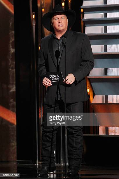Garth Brooks presents during the 48th annual CMA awards at the Bridgestone Arena on November 5 2014 in Nashville Tennessee