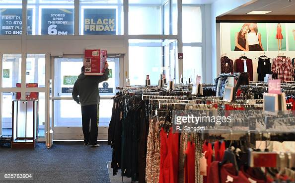 Garth Bryan heads to his car with a new vacuum cleaner that he bought at Kohl's in Lakewood November 25 2016 Customers shop sales during Black Friday