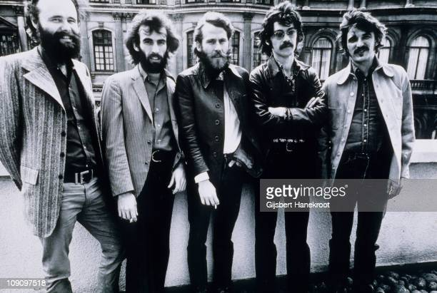 Garth Hudson Richard Manuel Levon Helm Robbie Robertson and Rick Danko of The Band pose for a group portrait in London in June 1971