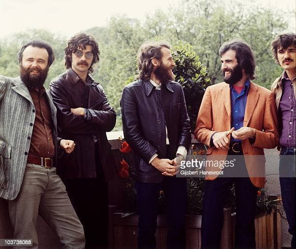 Garth Hudson Robbie Robertson Levon Helm Richard Manuel and Rick Danko of The Band pose for a group portrait in June 1971 in London
