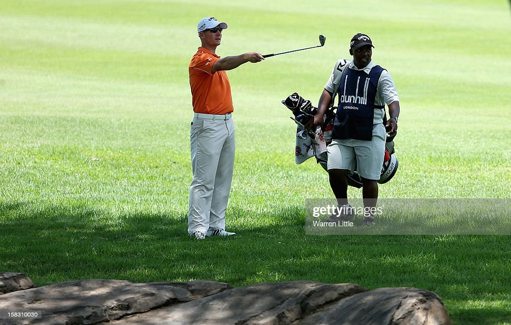 Garth Mulroy of South Africa points out the line to his caddie during the first round of the Alfred Dunhill Championship at Leopard Creek Country Golf Club on December 13, 2012 in Malelane, South Africa.