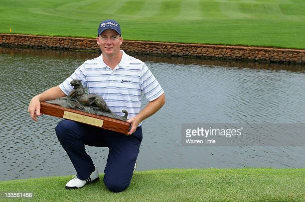 Garth Mulroy of South Africa poses with the trophy after winning the Alfred Dunhill Championships on a score of 19 under par at Leopard Creek Golf...