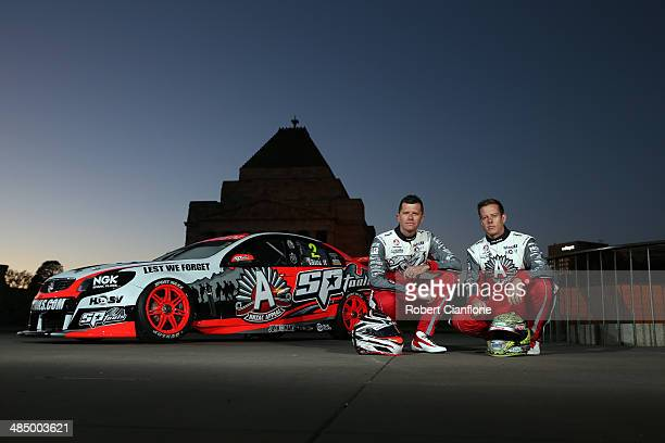 Garth Tander and James Courtney of the Holden Racing Team pose with one of their cars which will feature the ANZAC Appeal Rising Sun logo at the...