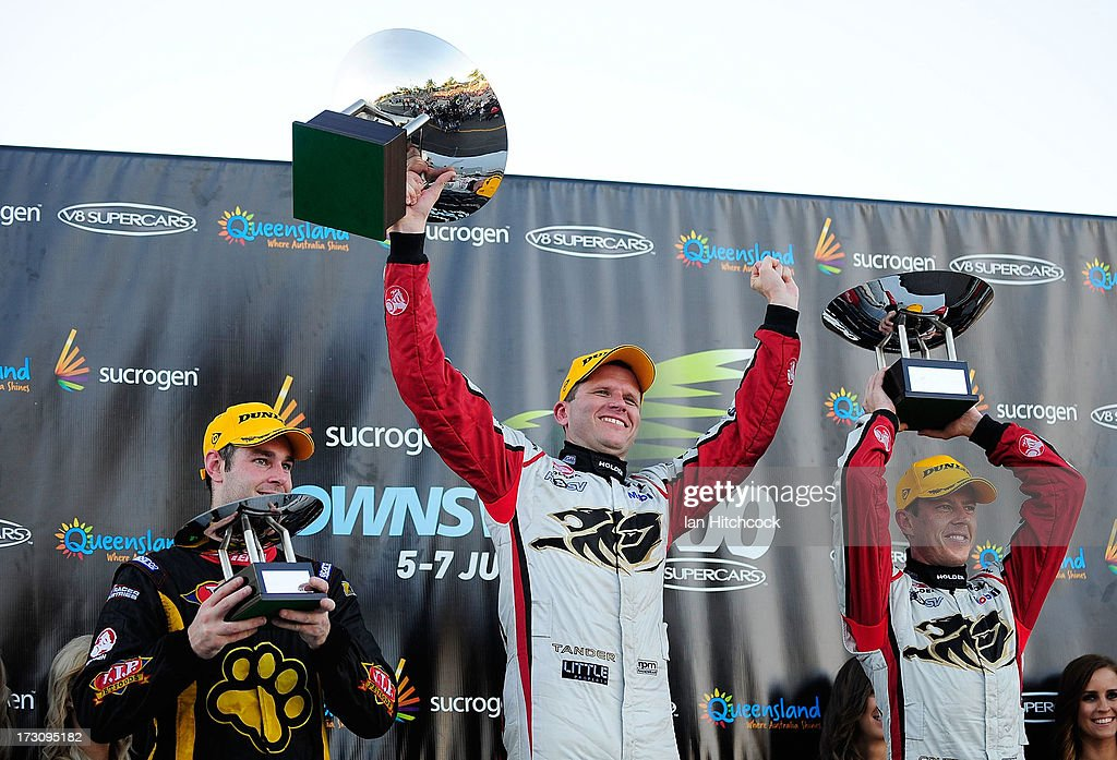 Garth Tander (c) celebrates with James Courtney (r) and Shane Van Gisbergen after winning race 21 of the Townsville 400, which is round seven of the V8 Supercar Championship Series at Reid Park on July 7, 2013 in Townsville, Australia.