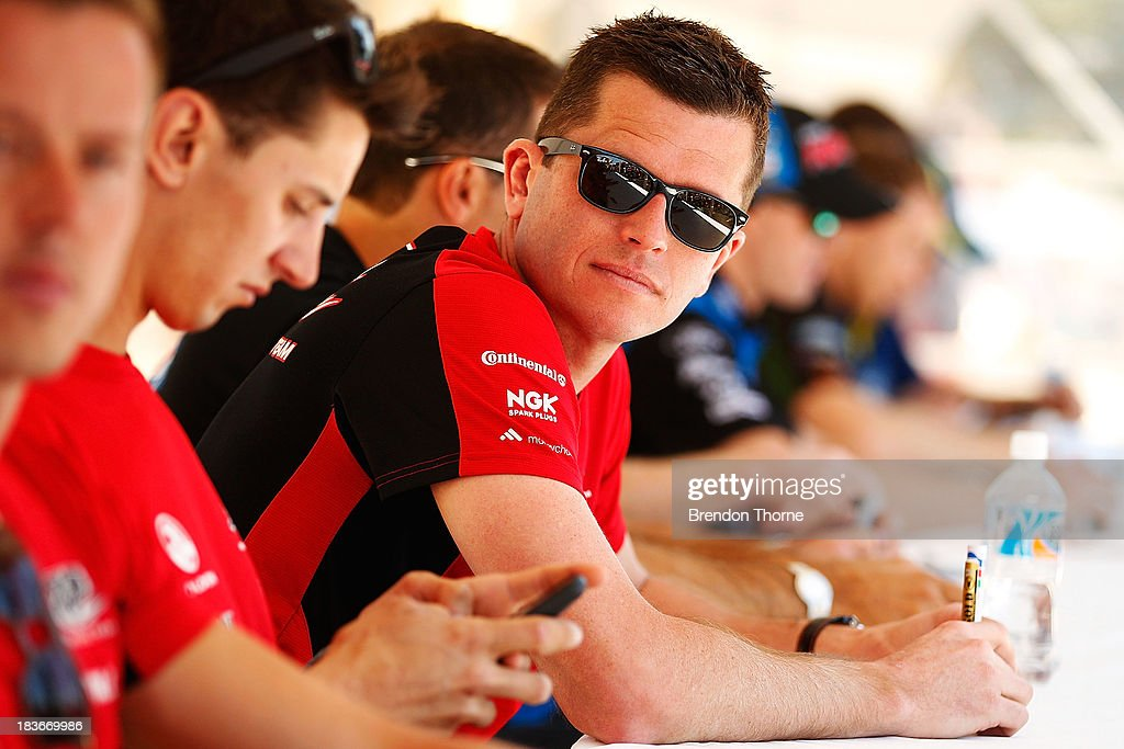 <a gi-track='captionPersonalityLinkClicked' href=/galleries/search?phrase=Garth+Tander&family=editorial&specificpeople=675225 ng-click='$event.stopPropagation()'>Garth Tander</a> driver of the #2 Holden Racing Team Holden looks on at an autograph session during previews ahead of the Bathurst 1000, which is round 11 of the V8 Supercars Championship Series on October 9, 2013 in Bathurst, Australia.