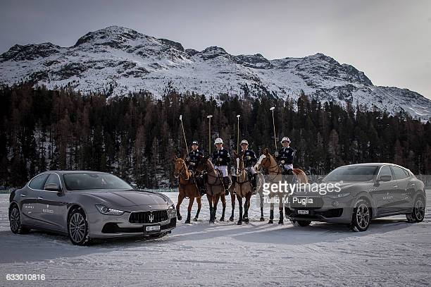 Garvy Beh Chevy Beh Joevy Beh and James Beh of Team Maserati pose with a Maserati Ghibli and a Maserati Levante during the Snow Polo World Cup St...