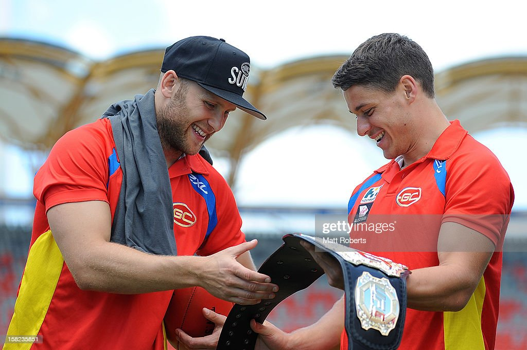 Gary Ablett and Dion Prestia of the Suns hold the UFC championship belt during a UFC media session with the AFL Gold Coast Suns at Metricon Stadium on December 12, 2012 on the Gold Coast, Australia.
