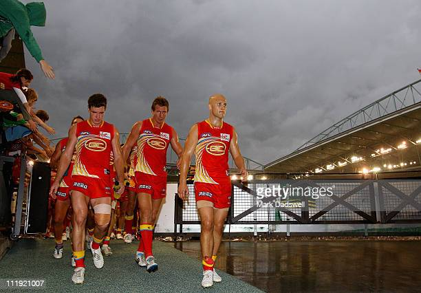 Gary Ablett captain of the Suns leads his team from the ground after their loss in the round three AFL match between the Western Bulldogs and the...