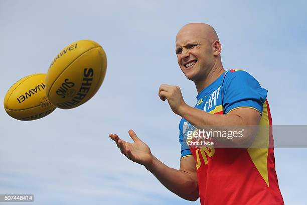 Gary Ablett handballs during a Gold Coast Suns AFL beach training session at Palm Beach on January 30 2016 in Gold Coast Australia