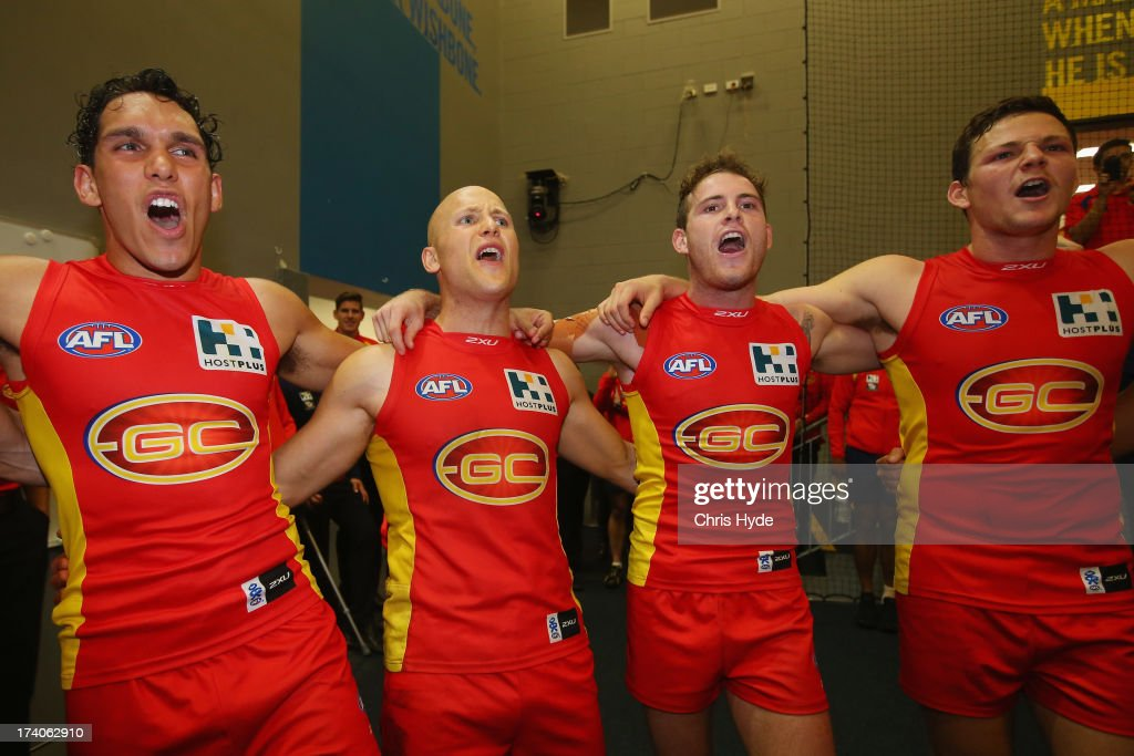 Gary Ablett, Harley Bennell, Luke Russell and Steven May of the Suns sing the team song after winning during the round 17 AFL match between the Gold Coast Suns and the Collingwood Magpies at Metricon Stadium on July 20, 2013 in Gold Coast, Australia.