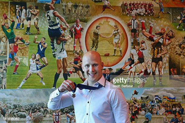 Gary Ablett Jnr of the Gold Coast Suns poses with the Brownlow medal at AFL House on September 24 2013 in Melbourne Australia Ablett won the 2013 AFL...