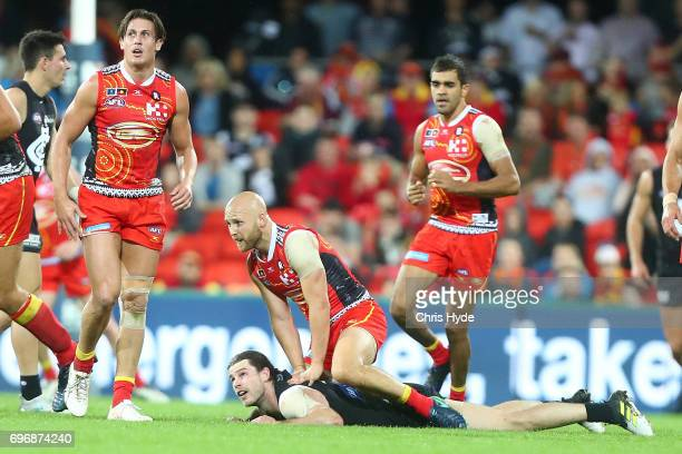 Gary Ablett of the Suns and Bryce Gibbs of the Blues grapple during the round 13 AFL match between the Gold Coast Suns and the Carlton Blues at...