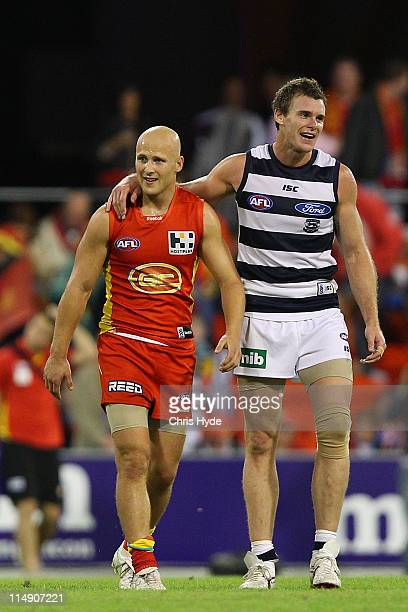 Gary Ablett of the Suns and Cameron Mooney after the round 10 AFL match between the Gold Coast Suns and Geelong Cats at Metricon Stadium on May 28...