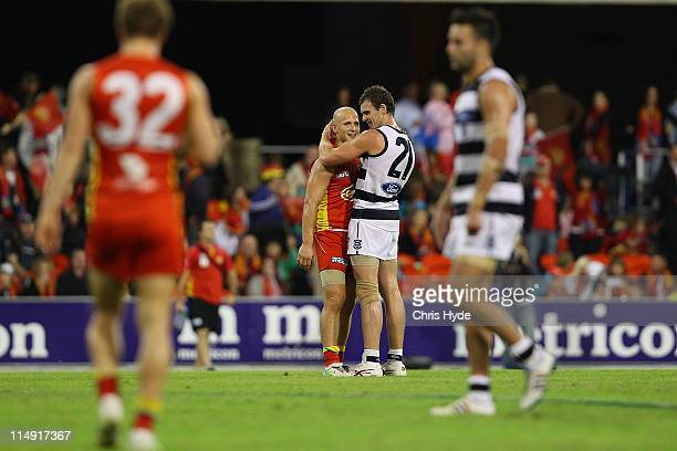 Gary Ablett of the Suns and Cameron Mooney Cats after the round 10 AFL match between the Gold Coast Suns and Geelong Cats at Metricon Stadium on May...