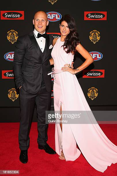 Gary Ablett of the Suns and his partner Jordan Papalia arrive ahead of the 2013 Brownlow Medal at Crown Palladium on September 23 2013 in Melbourne...