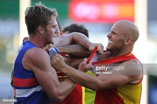 Gary Ablett of the Suns and Jake Stringer of the Bulldogs wrestle during the round 10 AFL match between the Gold Coast Suns and the Western Bulldogs...