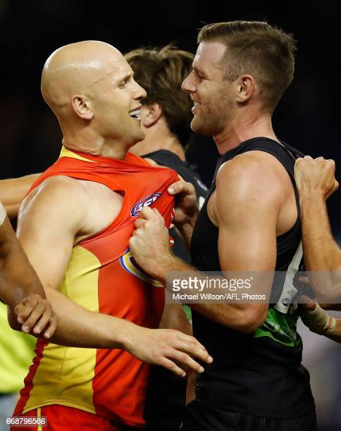 Gary Ablett of the Suns and Sam Docherty of the Blues wrestle during the 2017 AFL round 04 match between the Carlton Blues and the Gold Coast Suns at...