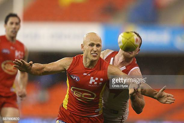 Gary Ablett of the Suns and Tom Mitchell of the Swans compete for the balll during the round 11 AFL match between the Gold Coast Suns and the Sydney...