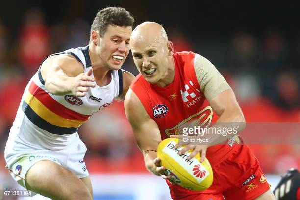 Gary Ablett of the Suns handballs during the round five AFL match between the Gold Coast Suns and the Adelaide Crows at Metricon Stadium on April 22...