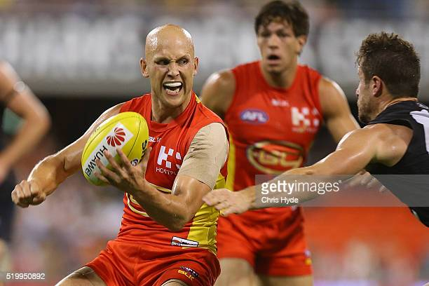 Gary Ablett of the Suns handballs during the round three AFL match between the Gold Coast Suns and the Carlton Blues at Metricon Stadium on April 9...