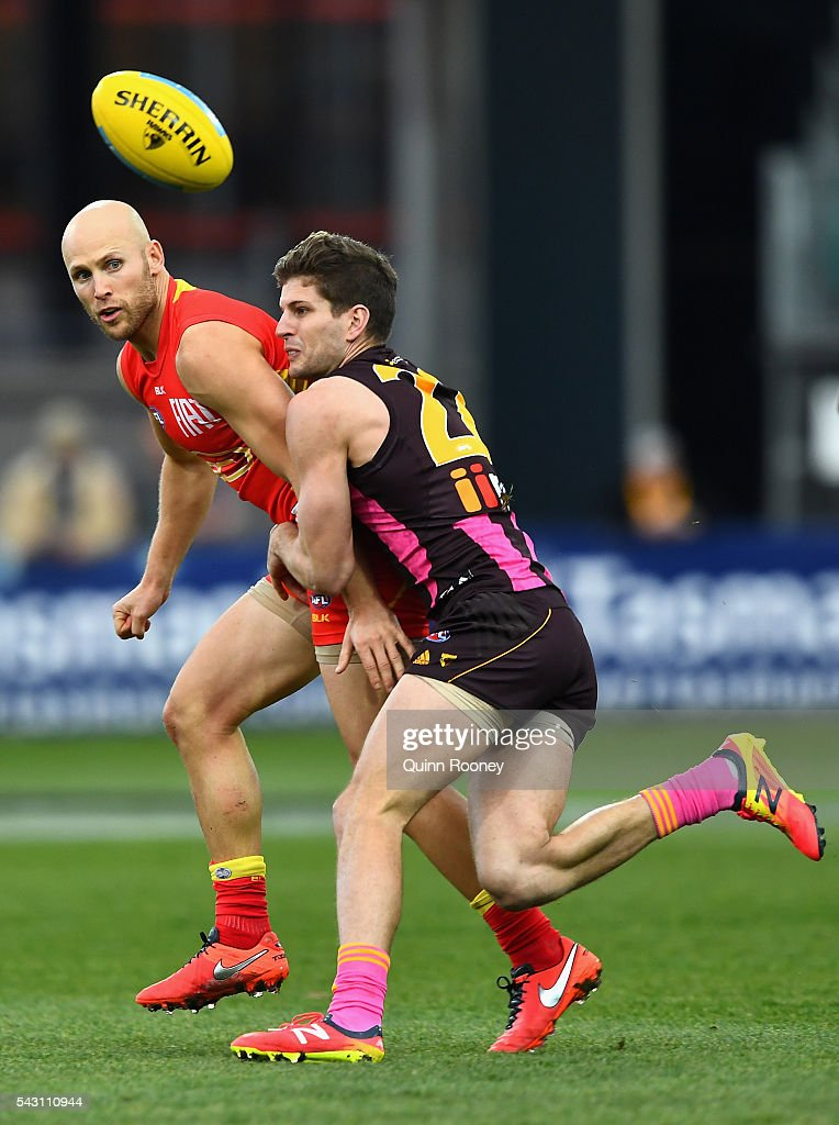 Gary Ablett of the Suns handballs whilst being tackled by Luke Breust of the Hawks during the round 14 AFL match between the Hawthorn Hawks and the Gold Coast Suns at Aurora Stadium on June 26, 2016 in Launceston, Australia.