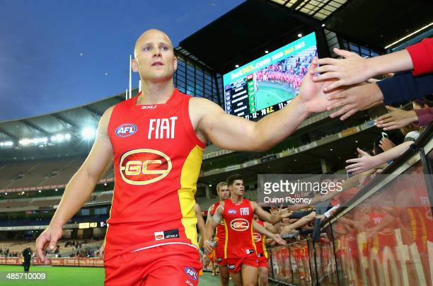 Gary Ablett of the Suns high fives fans after winning the round five AFL match between the Melbourne Demons and the Gold Coast Suns at Melbourne...