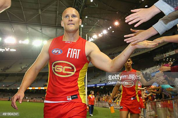 Gary Ablett of the Suns high fives fans after winning the round nine AFL match between the St Kilda Saints and the Gold Coast at Etihad Stadium on...